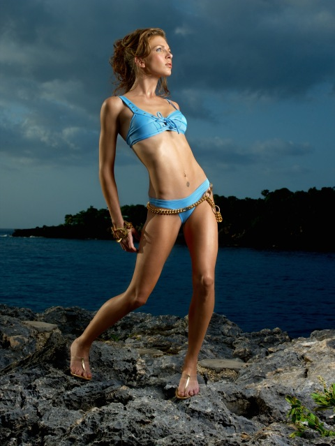 """302""--Amanda, mother; age 25 of Hendersonville, N.C.  models a swim suit on volcanic rock in Jamaica  in AMERICA'S NEXT TOP MODEL on UPN.  Photo:  Nick Cardillicchio/UPN.  ©2004 CBS Broadcasting Inc.  All Rights Reserved"