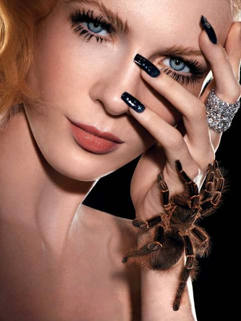 """The Girl Who is Panic Stricken""--Amanda, mother; age 25 of Hendersonville, N.C.,  models diamond jewelry, while also accessorized with a live tarantula in AMERICA'S NEXT TOP MODEL on UPN  Photo:Diodato/UPN.  (c) 2004 CBS Broadcasting Inc.  All Rights Reserved."