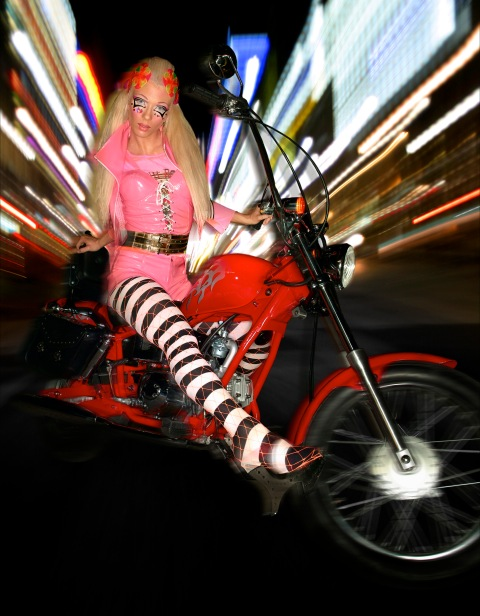 """The Girl Who Didn't Hug Goodbye""--Amanda, mother; age 25 of Hendersonville, N.C., in a Japanese anime look,poses on a motorcycle on the streets of Tokyo in AMERICA'S NEXT TOP MODEL on UPN.  Photo: Takahaski Mizzaki/UPN.  (c) 2004  CBS Broadcasting Inc.  All Rights Reserved"