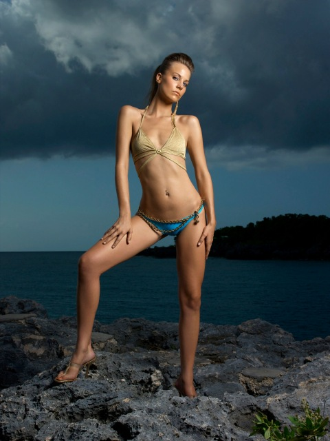"Image #: 865335    Cassie, a 19 year-old student from Norman, OK, models a swim suit on volcanic rock in Jamaica during an episode of the UPN reality television series ""America's Next Top Model.""    UPN /Landov"