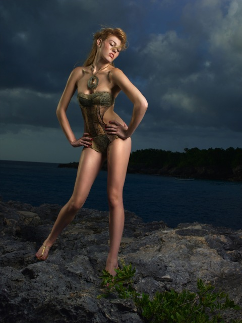 "Image #: 865341    Kristi, a 20 year-old student from St. Louis, models a swim suit on volcanic rock in Jamaica during an episode of the UPN reality television series ""America's Next Top Model.""    UPN /Landov"