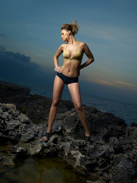 """Image #: 865342    Leah, a 24 year-old sales associate from Oklahoma City  models a swim suit on volcanic rock in Jamaica during an episode of the UPN reality television series """"America's Next Top Model.""""    UPN /Landov"""