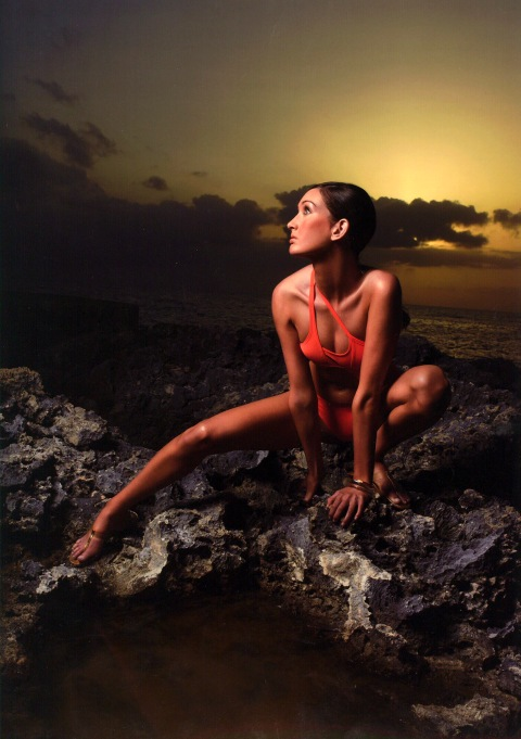 "Image #: 865347    Norelle, a 20 year-old sales associate from Newport Beach, CA, models a swim suit on volcanic rock in Jamaica during an episode of the UPN reality television series ""America's Next Top Model.""    UPN /Landov"