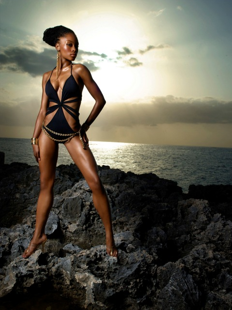 "Image #: 865345    Yaya, a 21 year old student from  Harlem, NY, models a swim suit on volcanic rock in Jamaica during an episode of the UPN reality television series ""America's Next Top Model.""    UPN /Landov"