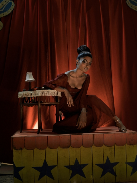 """The Girl Who Joined the Circus"" -- Anchal poses for the circus shoot in AMERICA'S NEXT TOP MODEL, Cycle 7, on The CW Television Network. Photo: Mike Rosenthal /The CW ©2006 The CW Network, LLC. All Rights Reserved."