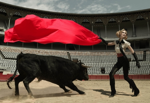 "Image #: 2771429    ""The Girl Who Sticks Her Foot In Her Mouth""--Melrose faces off against an angry bull while striking a dramatic pose in ""America's Next Top Model."" The CW/Nigel Barker /Landov"